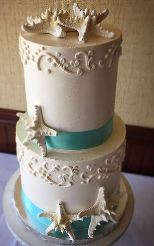 "2 tiered: 6"" / 8"" beach theme with piping"