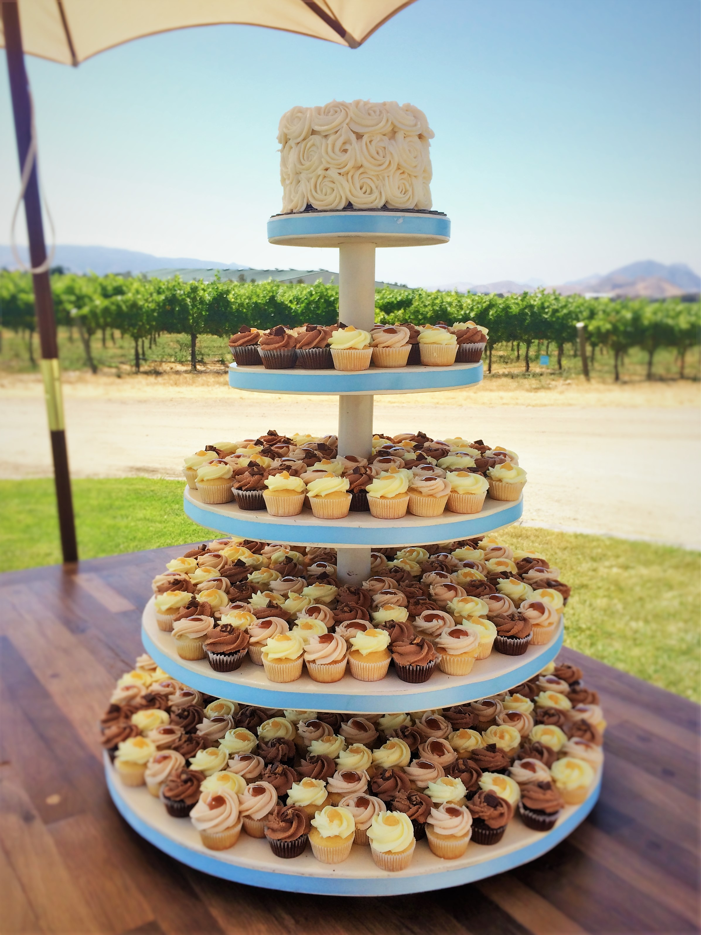 "360 mini cupcakes, 6"" buttercream rosette cutting cake"